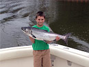 First ever King Salmon caught aboard the Originator Family-Friendly Fishing Charter.